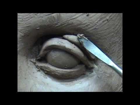 Sculpting open eyes in clay. Sculpting tutorial and demo how to sculpt eyes in clay.  Sculpting by Joanna Mozdzen www.joannamozdzen.com