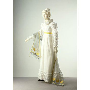 Dress and shawl, 1818. By the beginning of the 1820s, the waistline had started to move down. New historical influences are visible in dress styles. This particular example has a gathered collar in imitation of the ruffs of 16th century dress. The sleeve with a series of puffs down the arm was known as a 'Marie' sleeve, after a similar style worn by Marie de Médicis, Queen of France at the beginning of the 17th century.