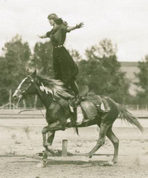 """Tillie Baldwin, a """"champion lady buckaroo,"""" does some fancy riding at the 1912 Pendleton Round-Up, Oregon"""