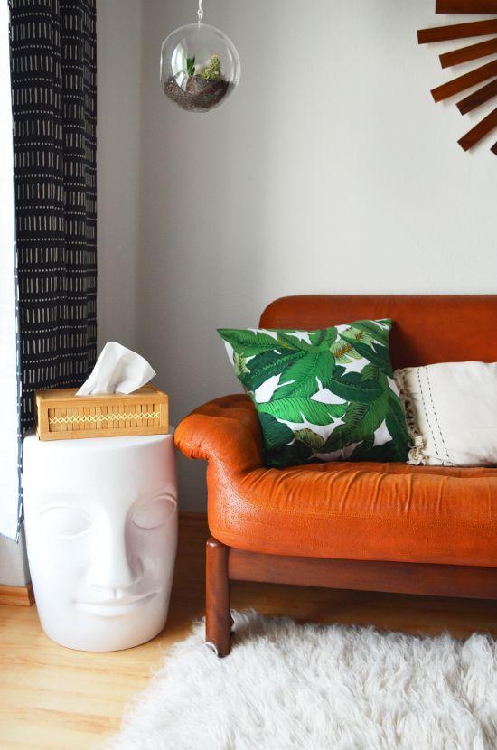 urban living room | banana leaf cushion | scandinavian boho | leather sofa | mid century