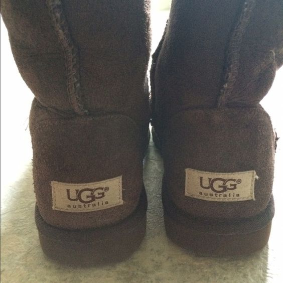 UGG Chocolate Brown boots Chocolate brown UGG boots. VERY LIGHTLY worn (will take pics of bottom soles). In very good shape. Fabric was sprayed with waterproof product. UGG Shoes Winter & Rain Boots