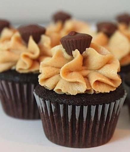 Dark chocolate cupcakes, Peanut butter frosting and Butter frosting on ...