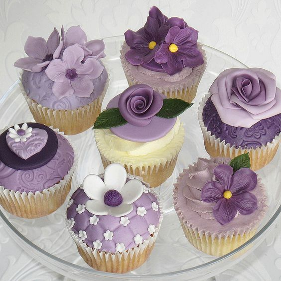 Purple / lavender / lilac pansy, rose and blossom cupcakes closeup