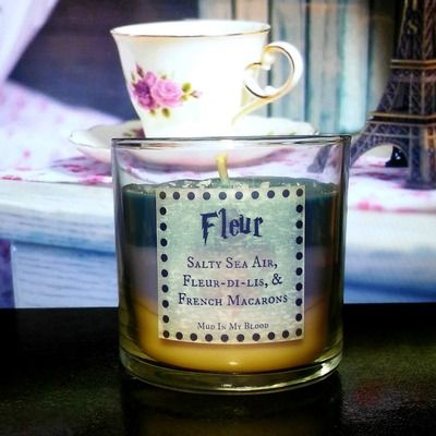 Fleur scented 4oz candle- salty sea air, fleur-de-lis, and french macarons