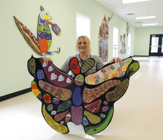 Cool group art project. Large mosaic with individually painted pieces. (Charlie the Caterpillar)