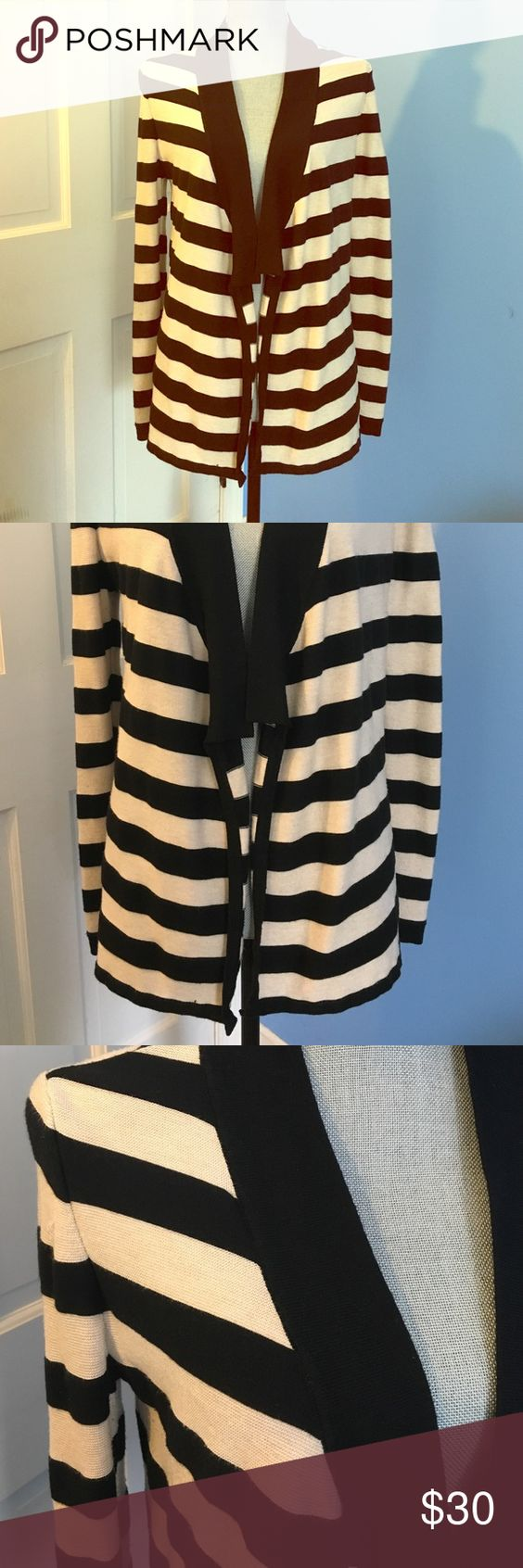 Tan and black striped open cardigan Tan and black striped cardigan, made to be left open, but I've also belted it with a skirt and boots. Stretchy, soft, and cozy in cool months. This is a great piece to have in the closet and is almost new. Great condition. White House Black Market Sweaters Cardigans