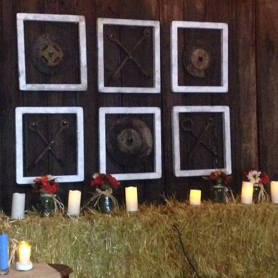 Rustic wedding decor. White washed frames and iron for XXXOOO