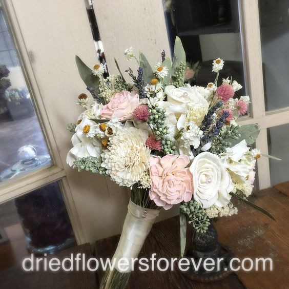 Naturalbouquetin blush, soft pink, creamy white, and moss green with gem accents.  Color customization available. Flowers include: seeded eucalyptus, wood sola, lavender, parchment hydrangea, ammobium, and more.