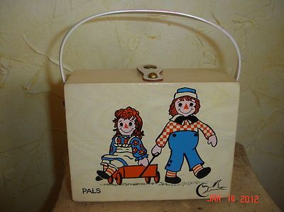 Raggedy Ann and Andy wooden purse by Enid Collins of Texas. Cute, expensive! Available on eBay