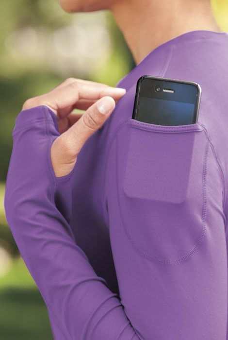 This Active Wear top has a shoulder pocket to hold phone or MP3, thumb holes, and UPF 50 to block 98% of sun rays!