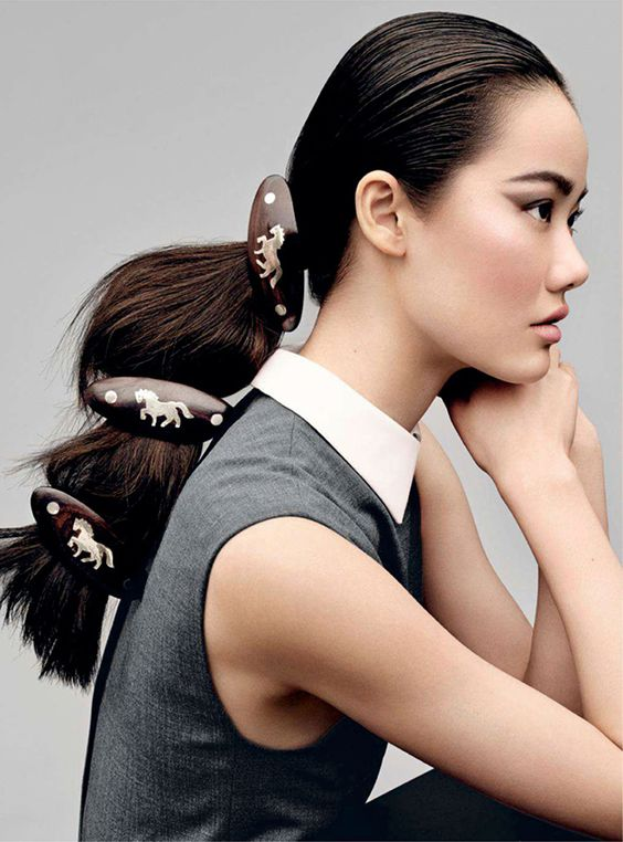 Here's what about hair. Love those clips. Guess you have to sit still in that pose for them not to flap around, though.