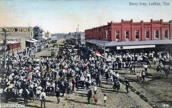1910 Lufkin Parade. Angelina Countians have turned out for a downtown parade. Lufkin Ave looking East from Cotton (Calder) Square. Red brick building is where Perry Bros building stands today.