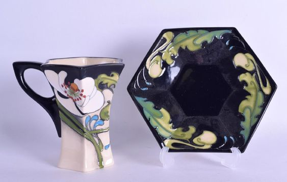 A MOORCROFT 'AU LAIT' CUP AND SAUCER designed by Emma Bossons - Coffee Cup