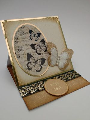 Beautiful easel card. I love her use of a pattern in the oval frame and all the butterflies