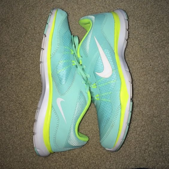 Brand new Nike Flex TR 5 Worn maybe once or twice! Bright aqua Nike running shoes. Super comfortable! No trades, sorry! Nike Shoes Athletic Shoes