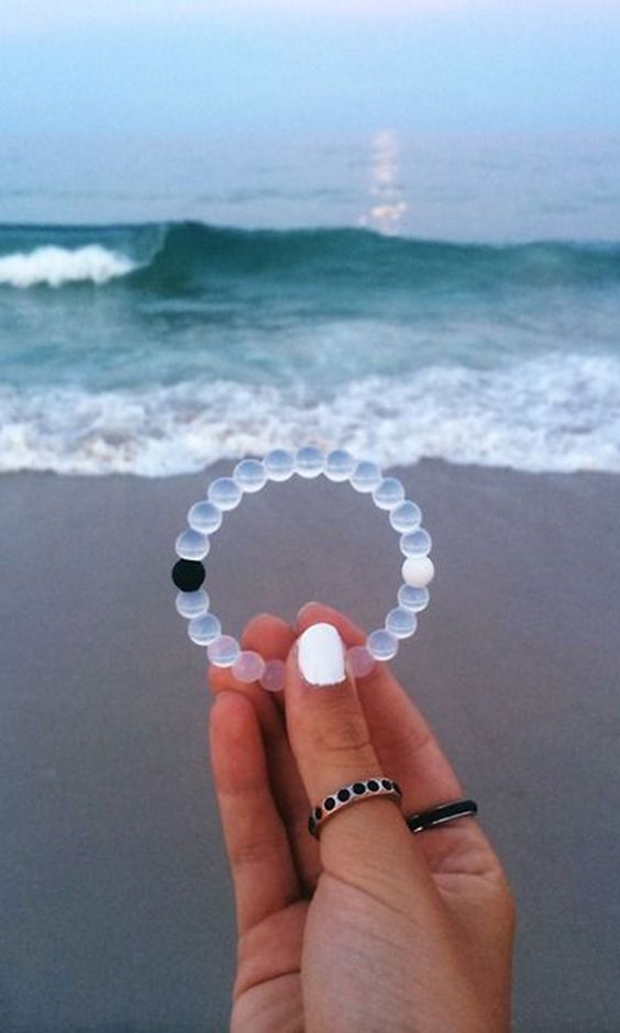Lokai serves as a little reminder to stay positive through life's challenges. Injected in the black bead is mud from The Dead Sea and in the white bead is water from Mt. Everest. The highest and lowest points on Earth!