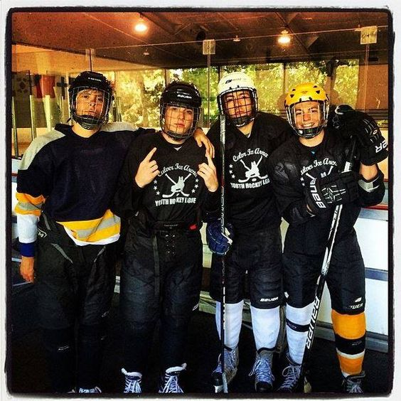The Lynch Boys playing Hockey! Ross and his yellow!