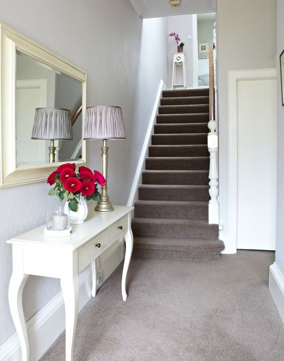 white traditional hallway with taupe carpet and french