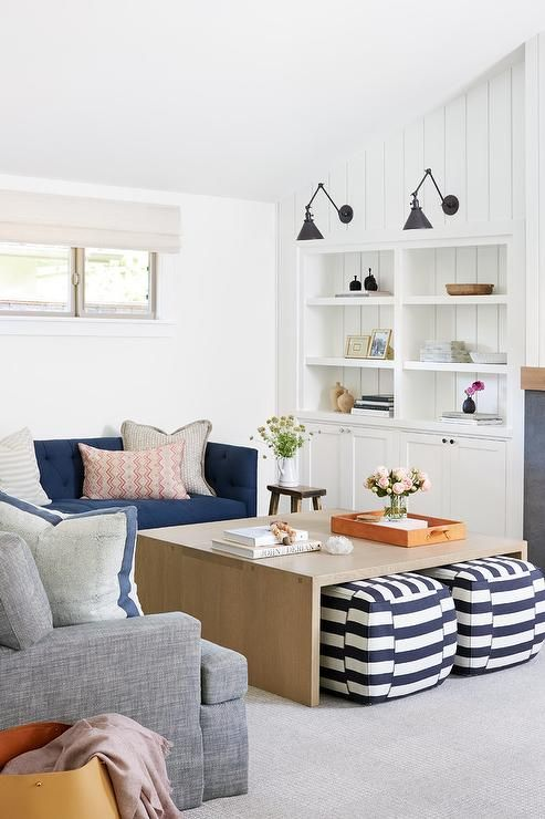 Well Designed Blue And Gray Living Room Boasts A Charcoal Gray Sofa Topped With Blue Borde Living Room Without Sofa Summer Living Room Decor Simple Living Room