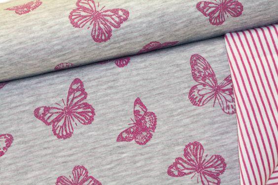 Doubleface Jersey in etwas schwerer Qualität.  Eine Seite mit Glitzer Schmetterlingen, die andere Seite ist geringelt.   Ideal zum Nähen von Kleidung, Mützen, Shirts,Pullis,zum Füttern von...