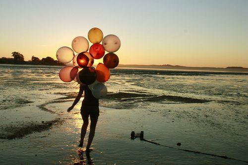 balloon girl beach sunset sea holidays