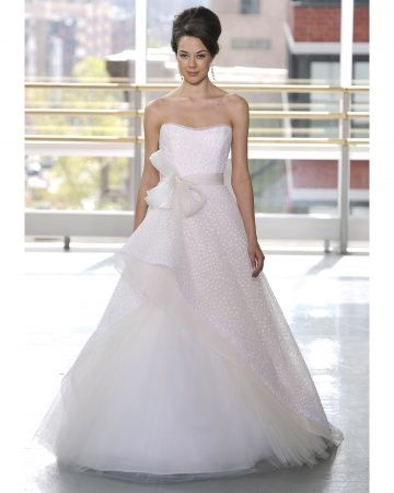 A ball gown by Rivini with an assymetrical tulle skirt. With the oversized bow and polka dot overlay, I think I'm in love with this sweet dress.