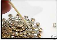 Vintage jewelry repair: How to re-glue rhinestones... SO doing this!
