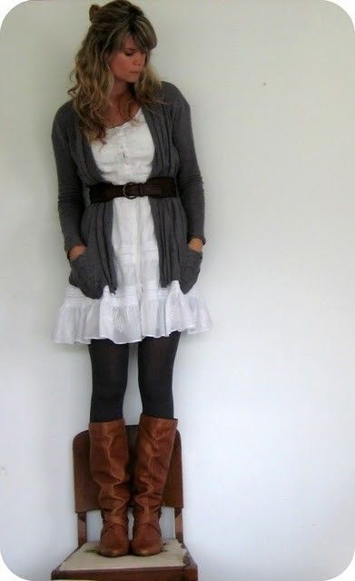 Lace dress, black tights, riding boots, Gray sweater and belt (Brown leather instead of black)