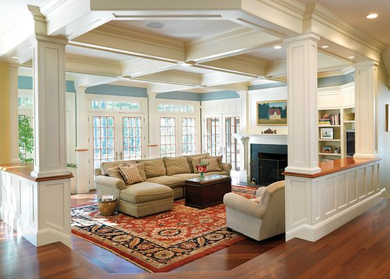 blue living room, coffered ceilings, hardwoods, builtins, windows, columns