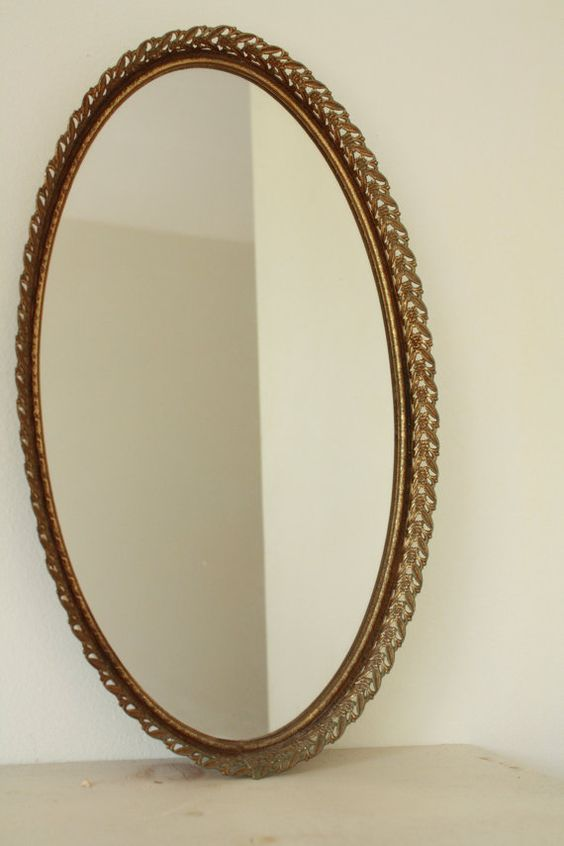 This listing is for a lovely vintage mirror tray. This mirror has a really beautiful gold ornate detail. It would look great propped up against the