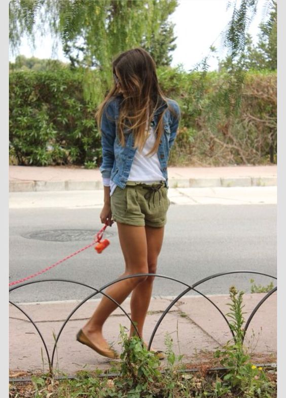 Best bet? Casual, girl next door vibe. Also, very natural looking. The white shirt and loose shorts look very free and light. This is an outfit that I could potentially see a kid wearing. Easy to move. Maybe she has buttons or stitching on her denim jacket, that's youthful.