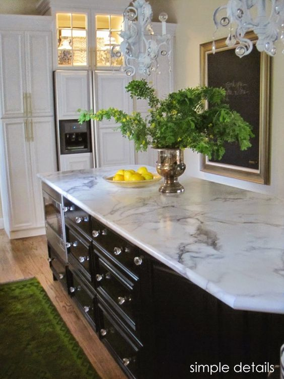 calacatta marble 180fx formica countertops look like marble with less maintenance. Shown on black painted kitchen cabinet