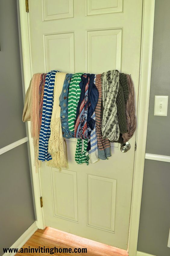 use a towel bar to store scarves