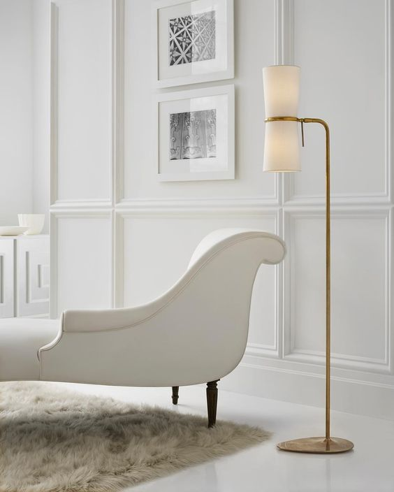 Curvy white chaise with sexy modern floor lamp in elegant room with glossy white floor. Bom-chicka-wah-wah!