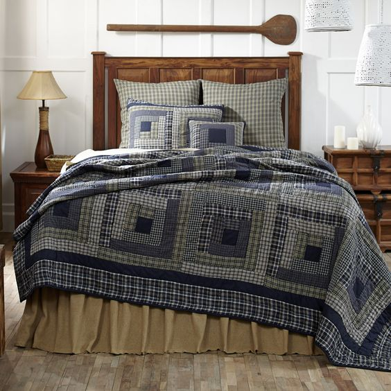 "Columbus Queen Quilt. The Columbus Queen Quilt features cabin patchwork block quilting with a collection of plaids in shades of navy blue and green.  Perfect for your country primitive cabin or cottage decor, there are six plaids that compose the quilt with solid navy accents and reverses to solid navy blue. The quilt and accessories are 100 percent cotton and machine washable.  Stitch in the ditch quilting.  The Queen Quilt measures 90"" x 90"".  Shams and Pillow Cases sold separately."
