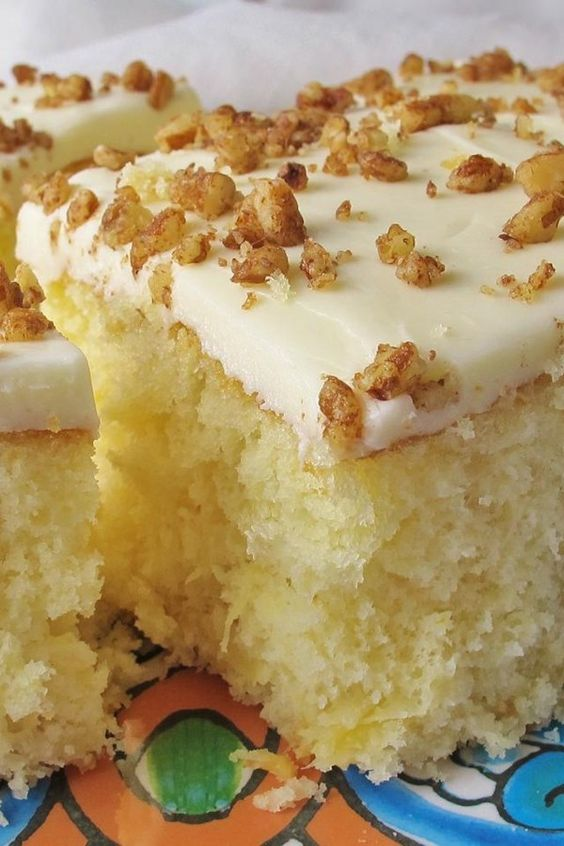 """Precious Pineapple Cake   """"This has to be my all time favorite cake. It is so moist and easy to make. Everyone who has tried it has asked for the recipe."""" #allrecipes #cakerecipes #bakingrecipes #dessertrecipes #cakes #cakeideas #vintagecakes #vintagecakerecipes #oldfashionedcakes"""
