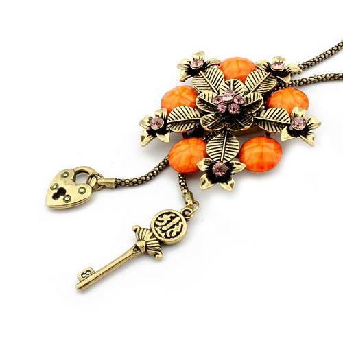 antique gold color plated with orange resin