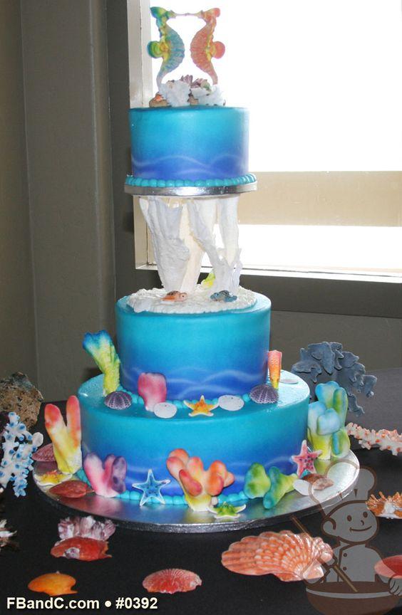 "Design W 0392 | Butter Cream Wedding Cake | 14""+8""+6"" | Serves 100 | Hand Sprayed Background, Hand Sprayed Corals and ceramic decor | Custom Quote"