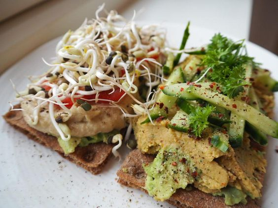 Breakfast time! Crispbread with avocado, homemade hummus, lentil & chickpea spread and homegrown beansprouts:
