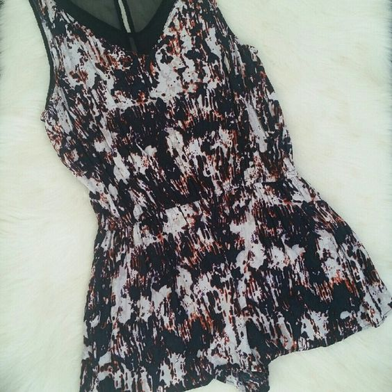Silence + Noise Multi Color Romper Romper has 2 front pockets. Condition: Excellent, lightly worn. Body: 100% rayon, Trim: 100% polyester. Made in China. NO TRADES! silence + noise Tops