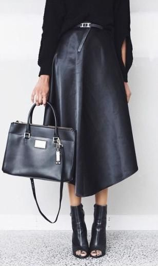 leather midi skirt. ankle boots.