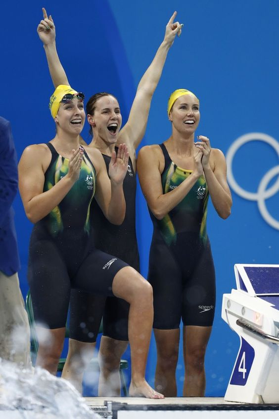 (FromL) Australia's Brittany Elmslie, Australia's Emma Mckeon and Australia's Bronte Campbell celebrate after they broke the world record to win the Women's 4x100m Freestyle Relay Final during the swimming event at the Rio 2016 Olympic Games at the Olympic Aquatics Stadium in Rio de Janeiro on August 6, 2016. / AFP / Odd ANDERSEN