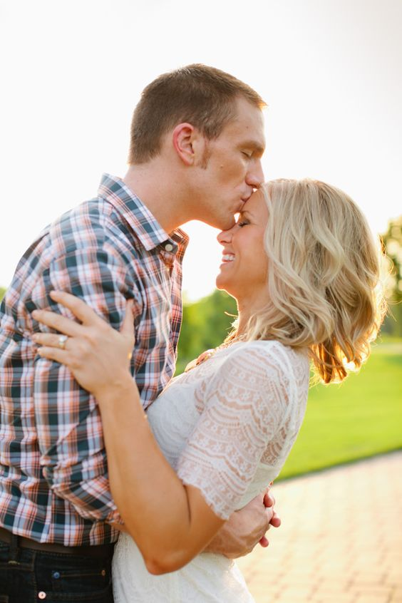 Forehead kiss, so sweet! Summer engagement photo shoot at Longfellow Gardens. Photo by Eileen K. Photography