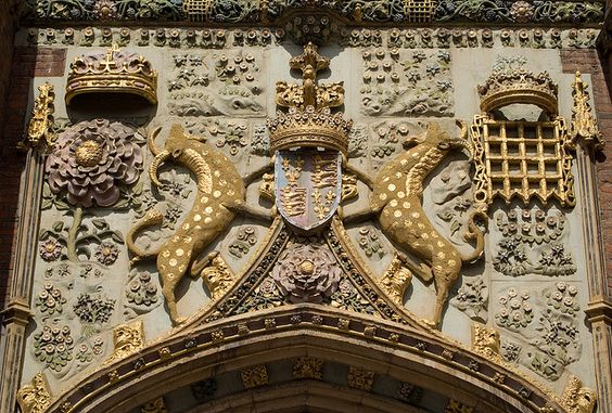 The decoration over the great gate of St John's, depicting the college arms supported by Yales, surrounded by Tudor and Beaufort symbols, and a host of marguerites and other flowers (a pun on the foundress' name, Margaret Beaufort).