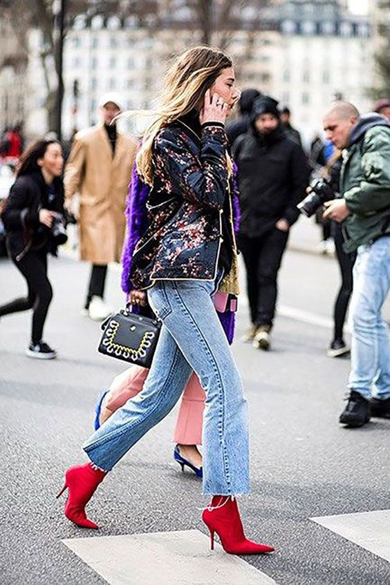 Chiara Capitani pairs red ankle booties with kick-flare raw-hem jeans and a baby pink handbag