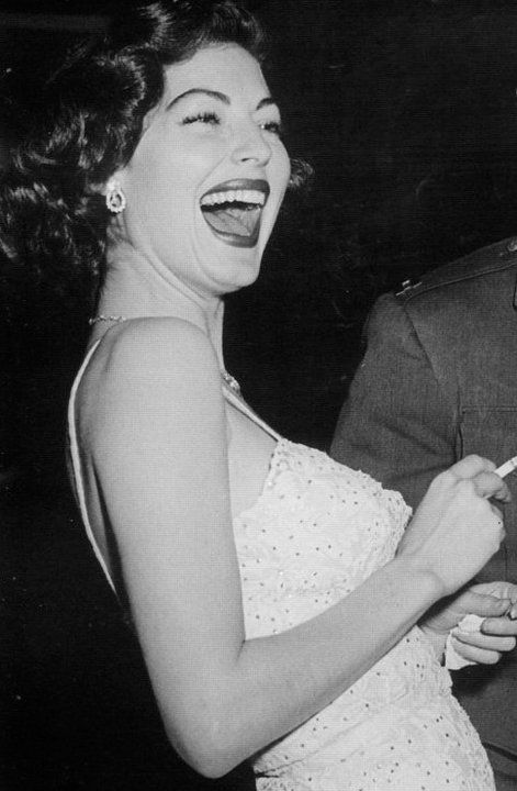Ava Gardner, laughing.