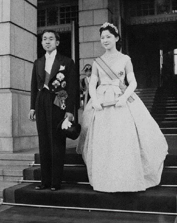 Japanese Crown Prince Akihito and his bride, Michiko Shoda, during a triumphant drive through the streets of Tokyo, 10 Apr 1959