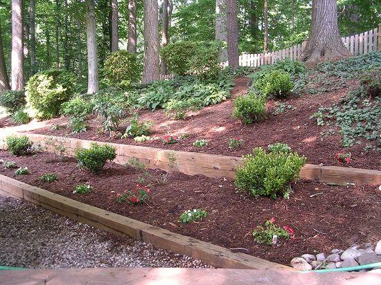 Diy retaining wall build a wooden retaining wall natural for Hillside rock garden designs