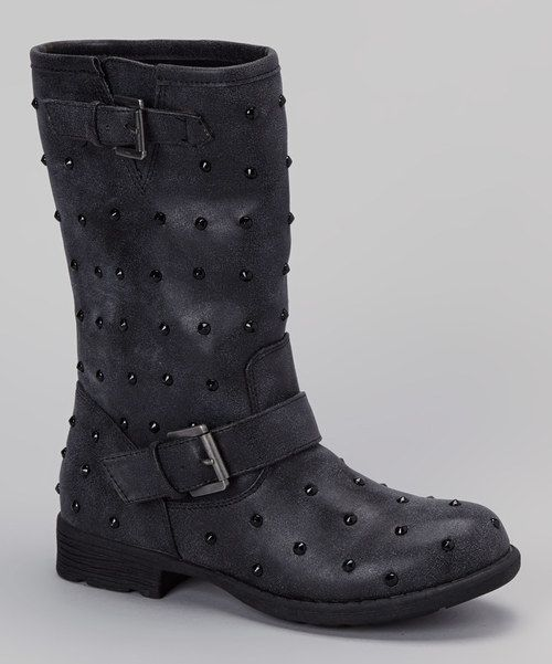 Step into style with these biker-inspired boots bedecked in studs. A sturdy traction sole makes strutting secure, while laces find a comfortable fit.1.25'' heel9.5'' shaft13'' circumferencePull-onMan-madeImported<...
