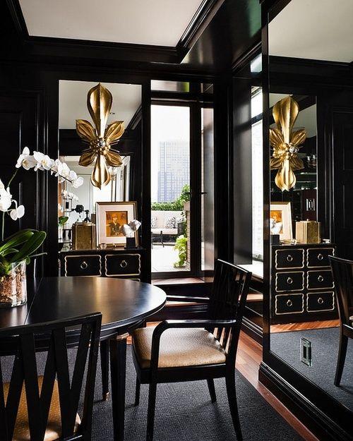Black, Gold and Mirrors, Excellent Use of Color, Materials and Placement Make This Room Seem Twice As Large.